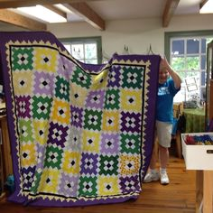 Marie T made this for one of her relatives, she always quilts an angel somewhere in the quilt. Can you find it?