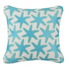 Sea Star images embroidered in turquoise are splashed across these elegant sea life pillows created by artist Jennifer Paganelli.