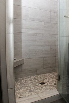Gray Tiled Shower With Accent Pebble Tile Floor