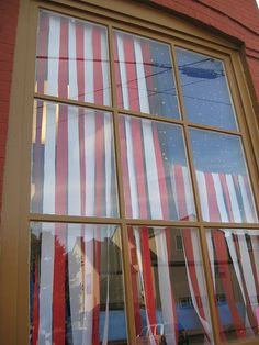 4th of july window display |  How clever to make an American flag out of crepe paper and christmas lights.