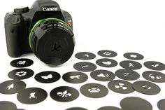 Photojojo bokeh kit - plastic filters that fit over your lens to turn bokeh into fun shapes! $25