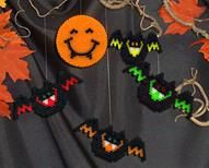 Vampire Moon and Bats - Designed By The Perler Design Team - Bloodthirsty bats fly by the light of the vampire moon—beware! Make these fun Halloween designs easily with Perler Beads.