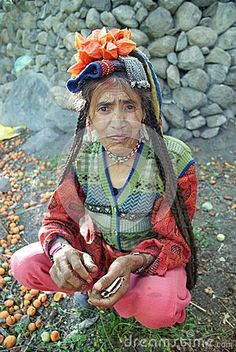 Portrait of elderly woman belonging to Drokpa or Brokpa tribe in traditional head covering and jewellery, Dha, Ladakh, India. the Drokpas claim to descend from Alexander the Great.