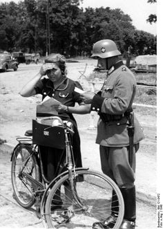 German Order Police checkpoint on the arterial road to Strasbourg, August 1940. The young lady appears justifiably fearful, especially since a man in uniform is also shooting her photograph. Such control exercises often resulted in unkind experiences at the slightest suspicion of foul play.
