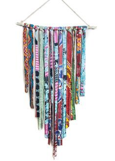 A wonderland of vibrant colors and vintage fabrics, this fun extra large wall hanging brings whimsy and delight into any room. Perfect to hang over a bed or add it to your favorite wall for a unique p