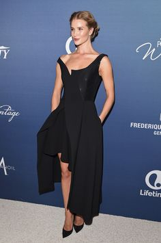 f36bff456ce Rosie Huntington-Whiteley wears a Stella McCartney black dress from our   Winter15 collection at