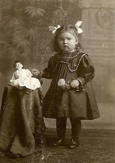 Girl and her doll via flickr                                                                                                                                                                                 More