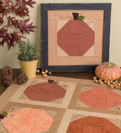 Harvest Duo table topper and framed quilt from the book Stitch on the Double by Kathleen Brown.