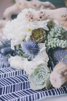 driftwood centerpiece with succulents and thistle, photo by Edyta Szyszlo http://ruffledblog.com/allied-arts-guild-wedding #centerpieces