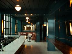 I love the design of this room! The Wythe Hotel.  Deep peacock wall color.
