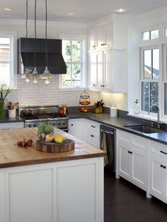 Artistic Designs For Living, Tineke Triggs's Design, Pictures, Remodel, Decor and Ideas - page 7....love black and white kitchens!
