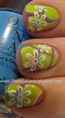 """""""For this manicureI did a water marble. first using a coat of OPI """"alpine snow"""" and then in the water I did   red SC """"Go Go Girl""""  green """"SHID """"Lickity split lime""""  blue OPI """"No room for the blues""""  purple CH """"Spontaneous"""""""""""