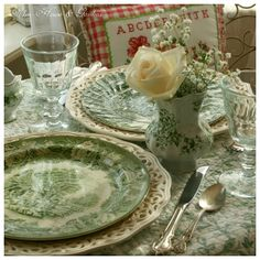 Green and white transferware dishes.