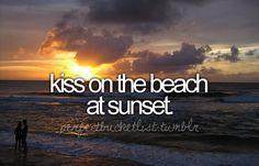 kiss on a beach at sunset