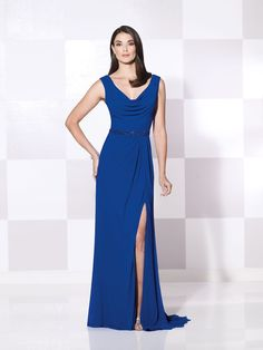 Sleeveless stretch mesh slim A-line gown with cowl neckline and deep V-back, hand-beading at natural waist, side draped skirt with left side slit and sweep train, suitable for wedding guests and formal events. Matching shawl included. As shown in Royal Blue: Jeweled Occasions earring style and bracelet style Valentina sold separately. As shown in Coral: …