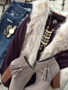 Fall & Winter Fashion - distressed jeans, plum top, faux fur vest, booties and gold accessories - fun date night or girl's night out!