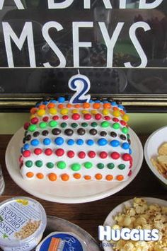 The centre was a chocolate cake with raspberry filling, covered with a white icing and rows of chocolate and peanut mms. The mms took ages to put on making sure all the mm logos were facing down and they all stuck in a straight line.