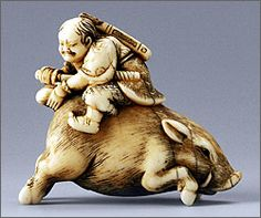 Netsuke of Nitta no Shiro slaying a boar, Okakoto of Kyoto, Japan, late 18th–early 19th centuries. Stained ivory and horn. H. 1 15/16""