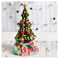 This fun-tastic miniature Christmas tree designed by Thienly is made by using the tree from COMET'S CANDY LAND SVG COLLECTION.  The tree is cut 6 times and glued together to form the tree. This is so awesome!  What a great centerpiece just to sit on the coffee table, or on your desk at home or work.  For complete instructions, check it out here:  http://svgcuts.com/blog/2013/11/21/a-very-merry-miniature-christmas-tree-by-thienly-azim/