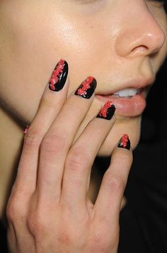red and black textured nail art