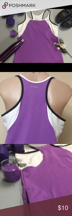 New Balance sports top with bra. Cute, pretty purple & white racer back sports top with bra. Mini zip pocket perfect for keys, debit cards etc. Split black and white spaghetti straps. Lining-87% polyester & shell-13% elastane. Lightning dry. New Balance Tops Tank Tops