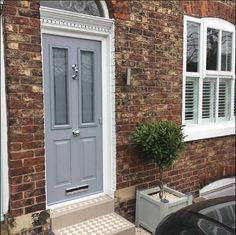 Front And Entry Doors For Your House – The Homeward View Grey Composite Front Door, Grey Front Doors, Painted Front Doors, Front Door Colors, Front Door Steps, Front Door Porch, Front Porch Design, House Front Door, Cottage Front Doors