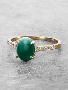 This beautiful forest green ring features a precious domed Emerald Cabochon Gem clasped in a four-prong Claw setting. A rare treasure; this beauty of whispers stories from another era, but is both mod