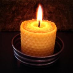 """Loving these pure beeswax candles from #CleanCouponing sponsor @Honey Dew Naturals !  Candlelight dinner, anyone? 3"""" Honeycomb Pillar- Burn Time: 15 to 17 hrs Elegantly purify your air with this organic beeswax candle. 100% toxin free with the naturals scent of honey."""