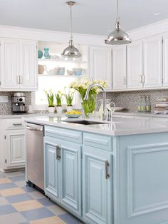 Kitchen Island with sink and powder blue cabinets.