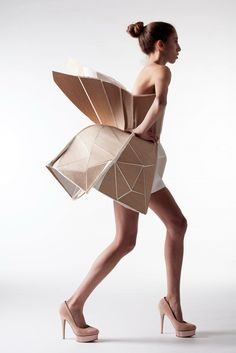 This origami dress reminds me of a peacock. I want to know what the materials they used are...