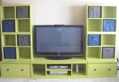 DIY Entertainment Center.  maybe for living room, but different color. This is kind of what I am after- but projection screen for tv,  and my retro tv graphic as wall art in center
