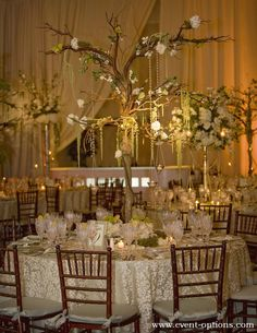 tree branch centerpiece with delicate flowers for an enchanted reception