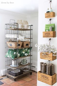 Open shelving holds patio pillows and accessories while nesting herb crates hold the tabletop necessities for the kitchen eat-in area