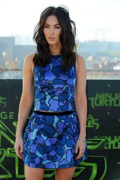 "Megan Fox dressed in Marc Jacobs colorful top and mini skirt at photocall for her latest movie ""Teenage Mutant Ninja Turtles"" in Berlin (October 2014)."