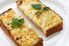 Croque Monsieur and bechamel sauce Ingredients Serves 4 4 items on sale  2 tbsp unsalted butter 3 tbsp all-purpose flour 2 cup hot milk 1 tsp kosher salt 1⁄2 tsp black pepper, freshly ground 1 pinch nutmeg 12 oz gruyere cheese, grated (5 cups), divided 1⁄2 cup parmesan cheese, freshly grated 16 slice white sandwich bread, crusts removed 1 dijon mustard 8 oz baked virginia ham, sliced, but not paper thin