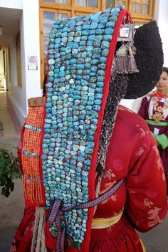 Ladakhi woman with perak (headdress) of turquoise with coral and silver