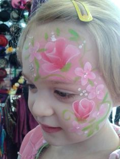 Delicate rose face painting by Eleanor Ross, spectrum face painting & Body Art.