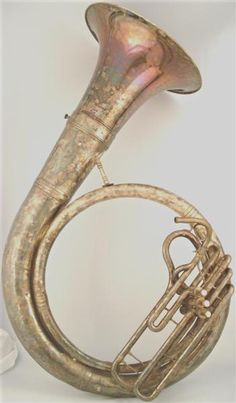 Some kind of BBb brass bass. Shown here is a Helicon made around the time of the first world war.