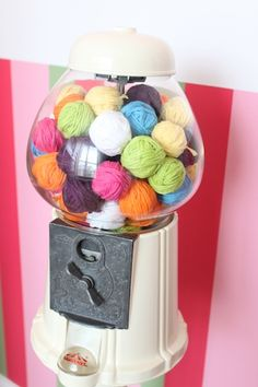 painted gum ball machine filled with yarn