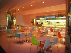 A colorful interior will help attract customers to your Ice Cream Shops. Ice Cream Decorations, Interior Design Classes, Android, Ice Cream Treats, Ice Cream Parlor, How To Attract Customers, Colorful Chairs, Food Court, Shop Interiors