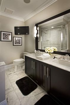 Contemporary Master Bathroom with Flush, Calacatta Carrara Marble Countertop, Double sink, frameless showerdoor, Wall sconce