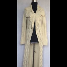Secrets mine long cableknit sweater jacket This long cable knit sweater jacket is a creamy angora blend. Size medium Jackets & Coats