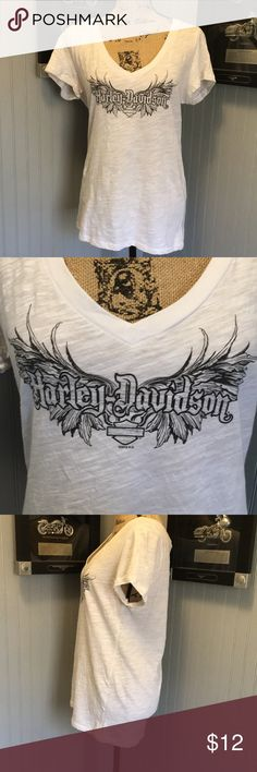 "Harley Davidson V-Neck T-Shirt GUC. A cute comfortable vneck T-shirt. Has wings and Harley Davidson on front. Dealership on back. Runs small. Length 23"". Armpit to armpit 20"" Harley-Davidson Tops Tees - Short Sleeve"