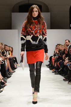 Great pullover with intriguing design, paired with a red skirt -- fabulous!
