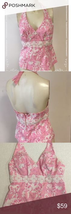 "Lilly Pulitzer Run for the Roses Halter Top 6 Beautiful halter top from Lilly Pulitzer in size 6  Pattern is called Run for the Roses with with pink and white Rhinos   Lace trim under the bust  Halter style with back zip . Ties behind the neck  97% cotton/3% spandex- machine washable cold  Excellent condition  Bust- 16-16.5"" Length- 10"" top of back to hem Lilly Pulitzer Tops"