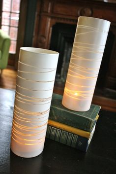 Take an old vase, place rubber bands around it, and spray paint it white...what an awesome idea!