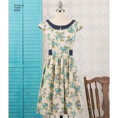 Gertrude Made vintage-inspired dress by Cathi Bessel Browne. Style is perfect for printed fabric and includes contrasting sash or collar and tabs. Simplicity sewing pattern.