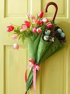 Better than a wreath. Get an old used umbrella from a thrift store and have fun decorating it.   Easter/Spring Door Decor