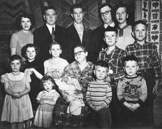 So poor, so many. The older girls trying to look their best in red lipstick and curled hair and neck scarves, the youngest boys filthy and wearing too small clothes, like my dad, the 10th child of 13, wearing his Will Rogers shirt. They hung the quilts and blankets in the background.  Darke County Ohio, mid 1950s.