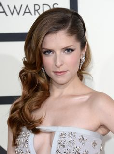 Pixie cuts aren't the only style that can exude confidence. Slick back one side of your hair, pulling it all to over one shoulder, and use a large curling iron to create this spectacular look.   - MarieClaire.com